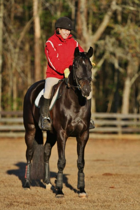 """These days, Elizabeth Barron doesn't compete with """"Cleo,"""" but she still takes lessons and works on improvements at both jumping and dressage. Photo courtesy Elizabeth Barron."""
