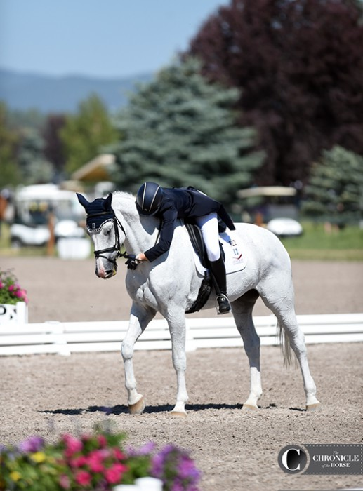 Haley Carspecken hugged Center Stage after their one-star dressage test, which has them placed second individually and helped boost the Area II team into first after dressage.