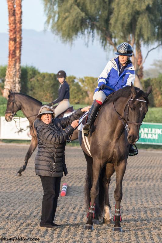 helping amateur rider Jasmine Talley adjust stirrups._O0A1059