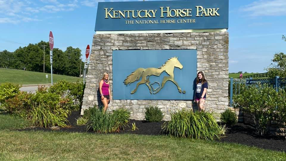 In font of Kentucky sign