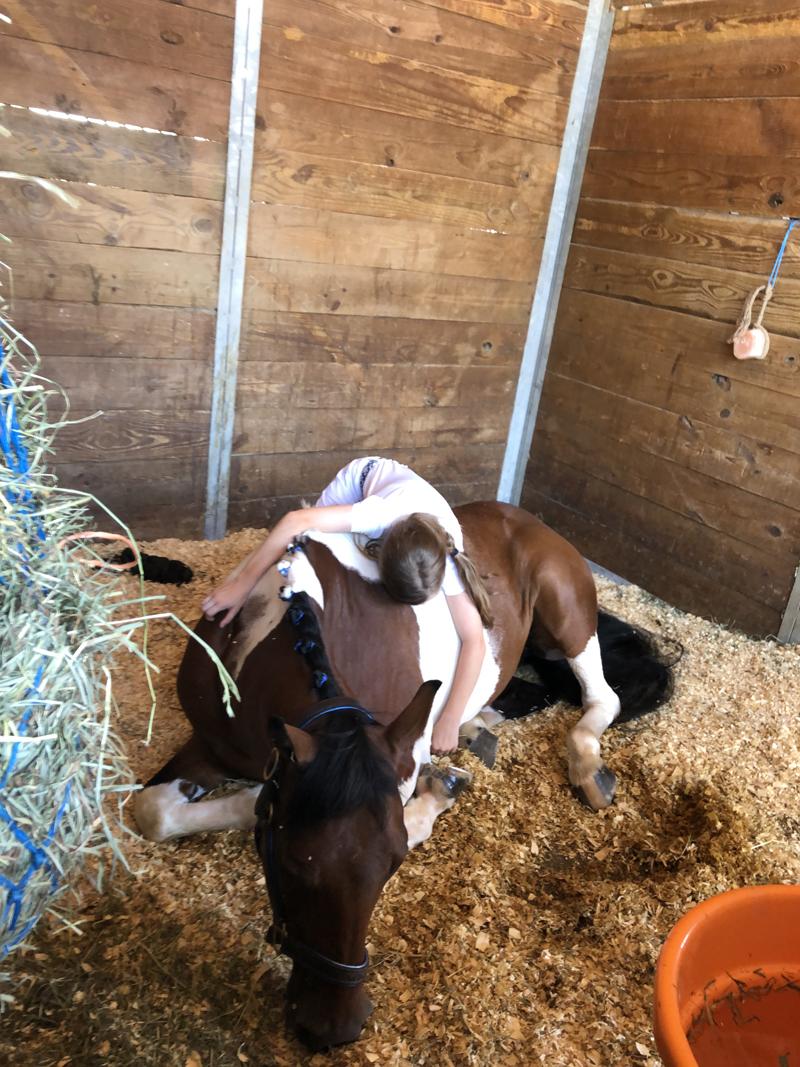 Riley hugging her pony
